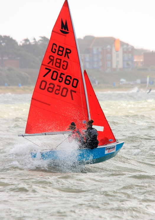 Mirror Dinghy partly airborne sailing fast on a reach