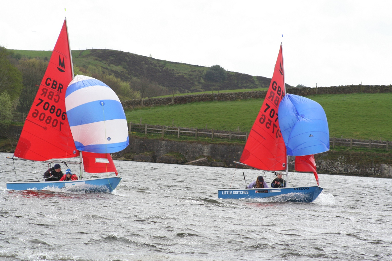 Mirror dinghies  flying spinnakers on a grey day