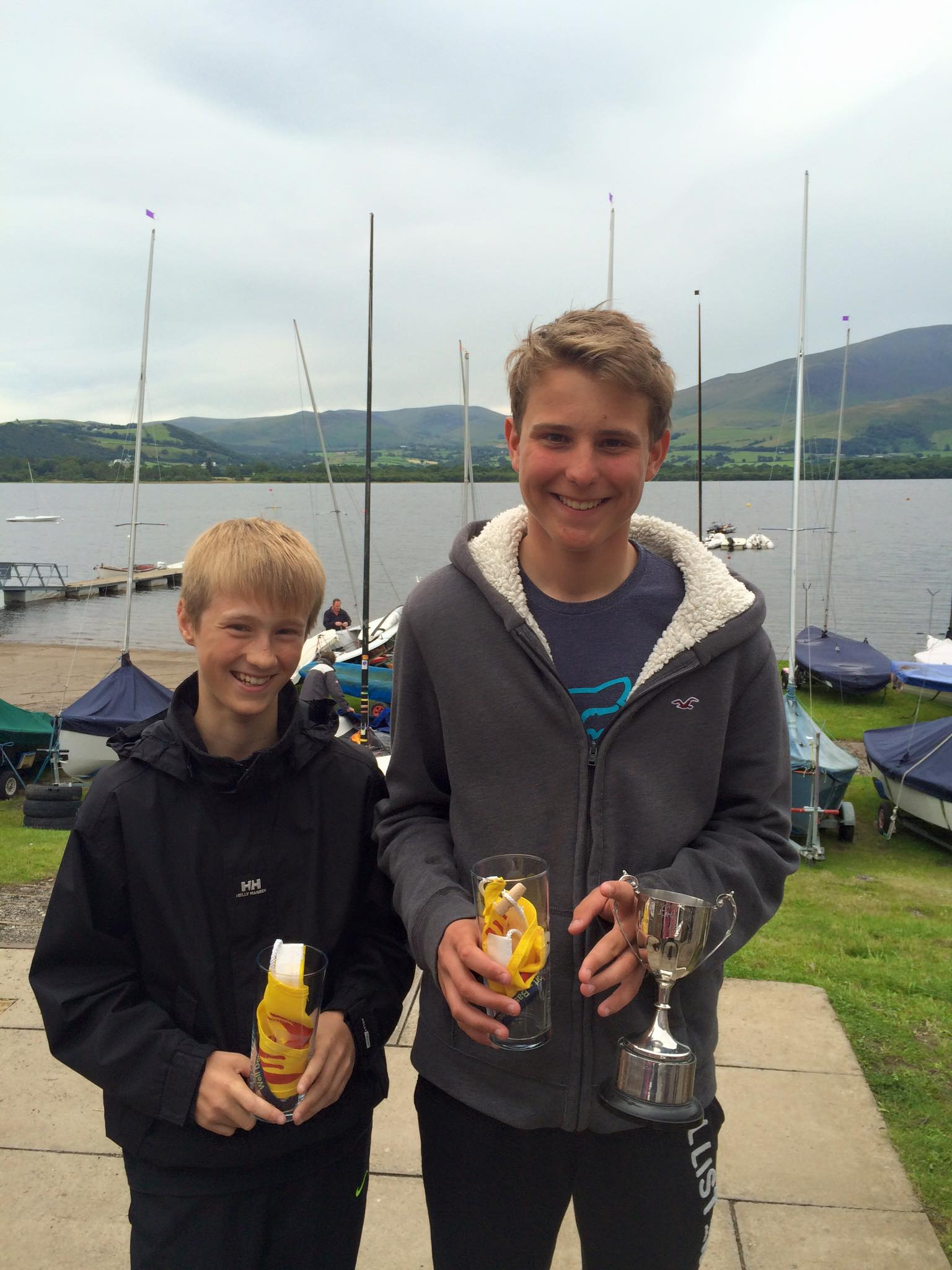 Two teenagers with cup and prizes