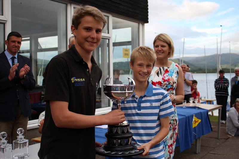 Two young Mirror sailors with a big trophy