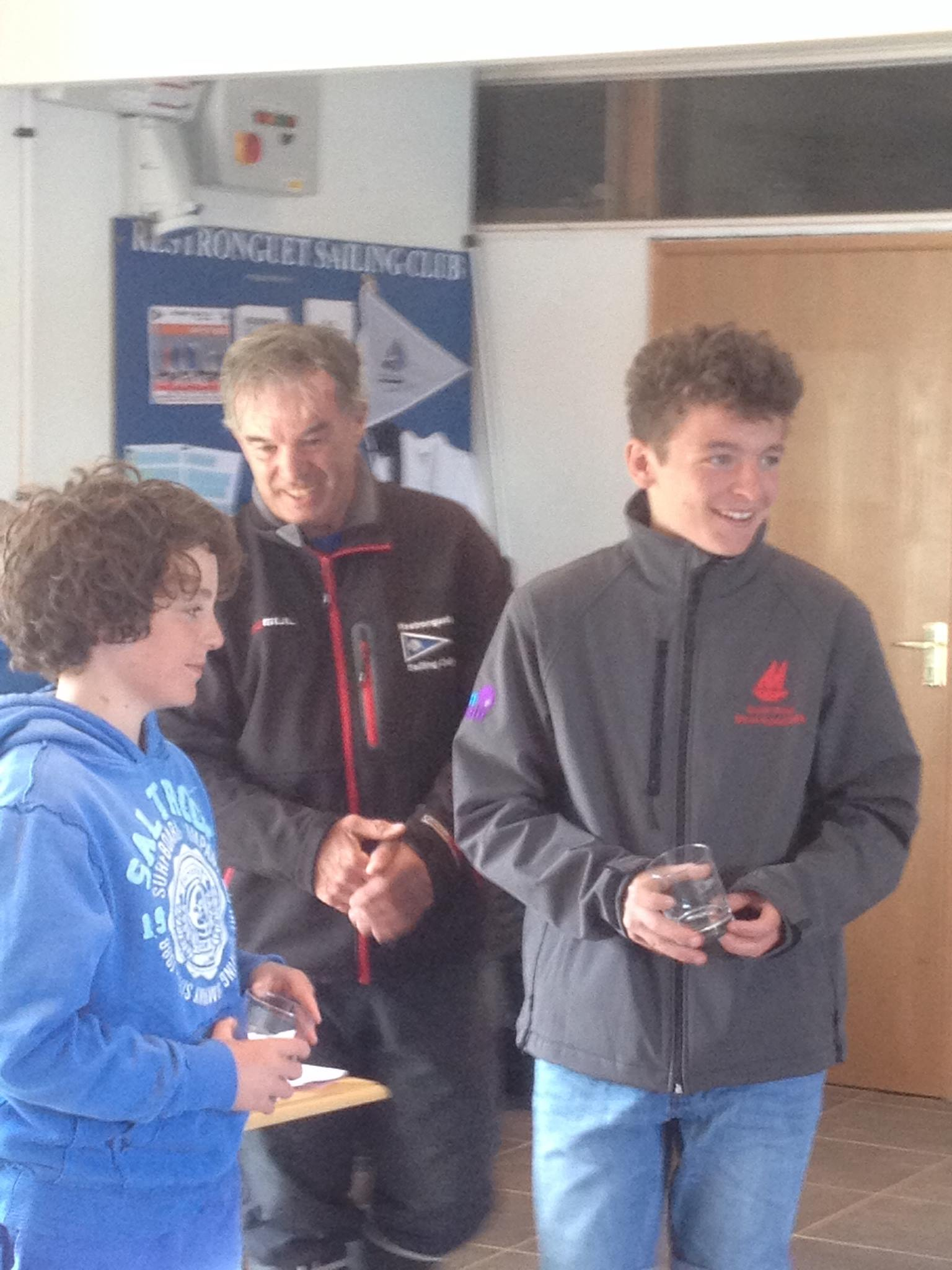 Two boys collecting their prizes from RSC Sailing Secretary