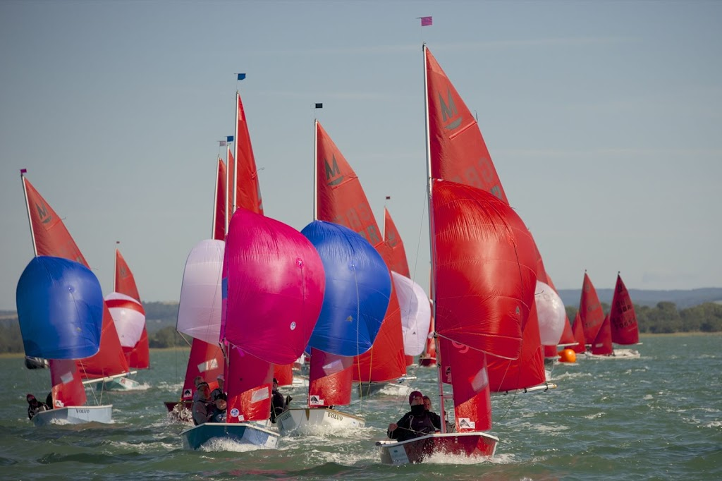 Mirrors racing on a reach with spinnakers flying