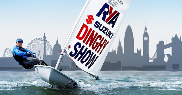 A laser dinghy sailing  towards camera with London skyline in the background