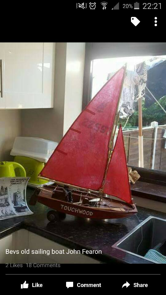 A model of a Mirror dinghy on a kitchen worktop