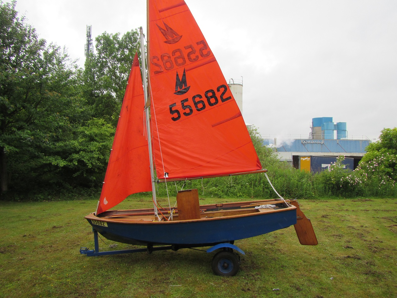 A Mirror dinghy rigged in a field