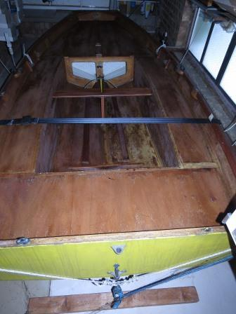 A wooden Mirror dinghy with yellow hull