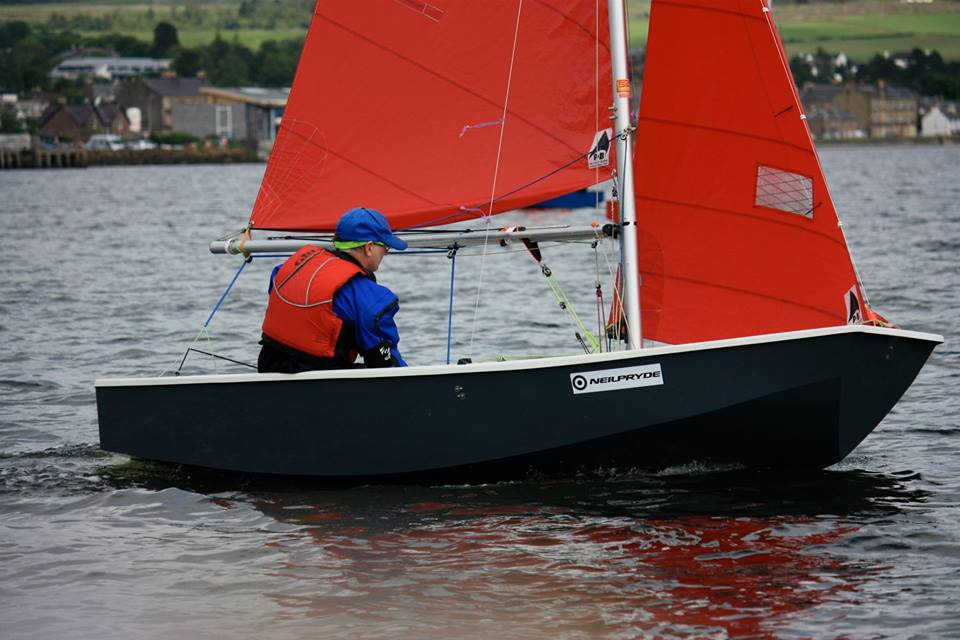 Dark grey Mirror being sailed to windward singlehanded