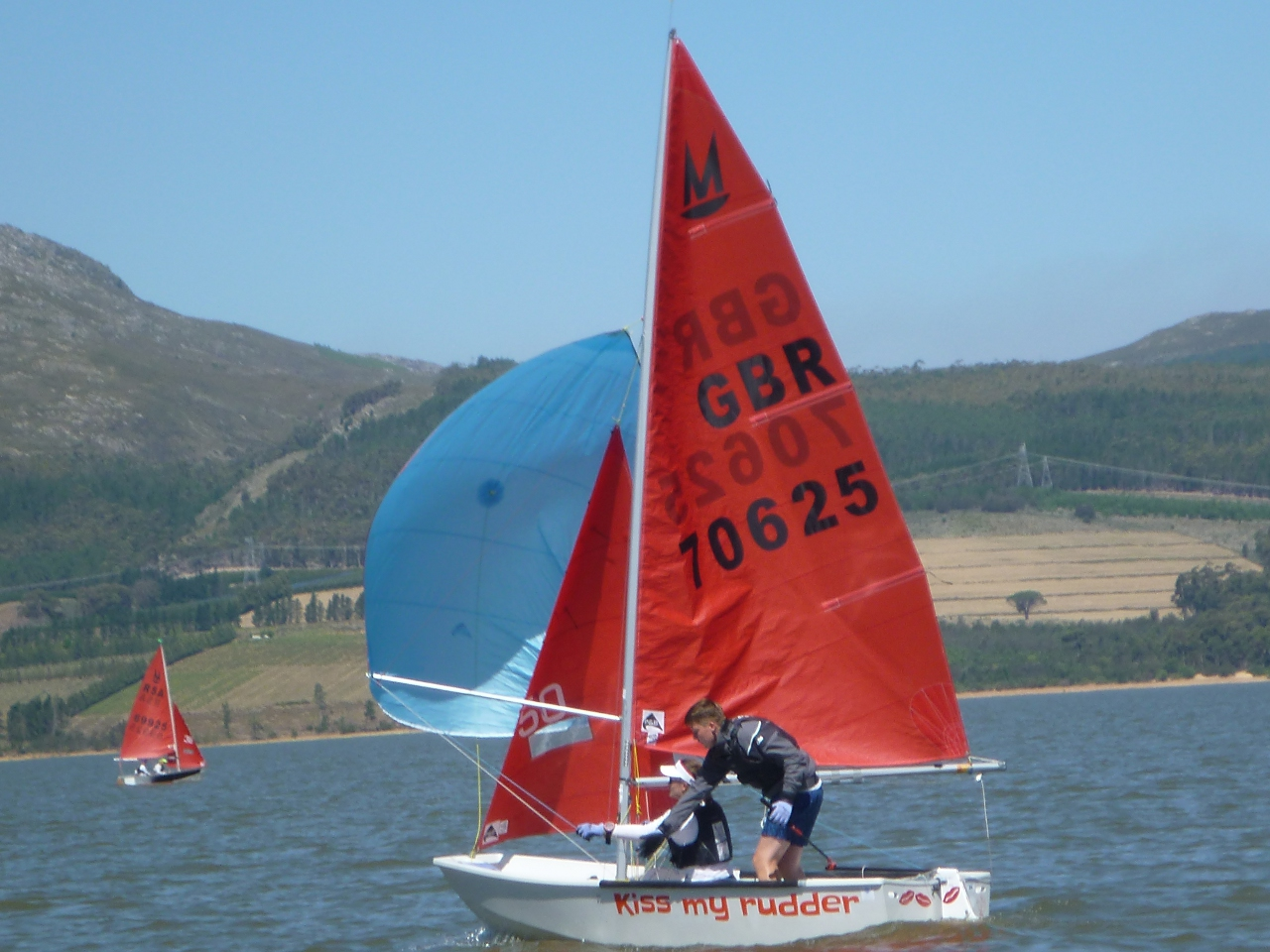 A white Mirror dinghy sailing on Theewaters reservoir in South Africa