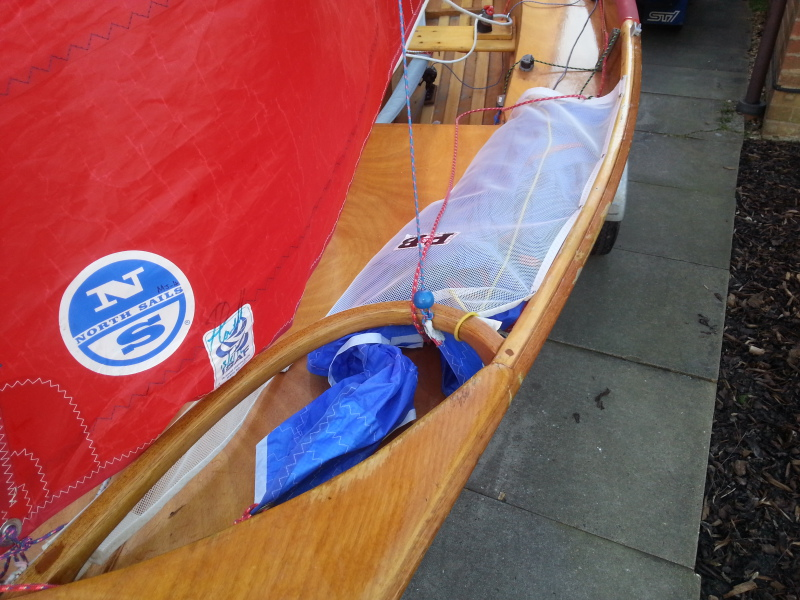 Wooden spinnaker chute hoop and sock on a wooden Mirror dinghy