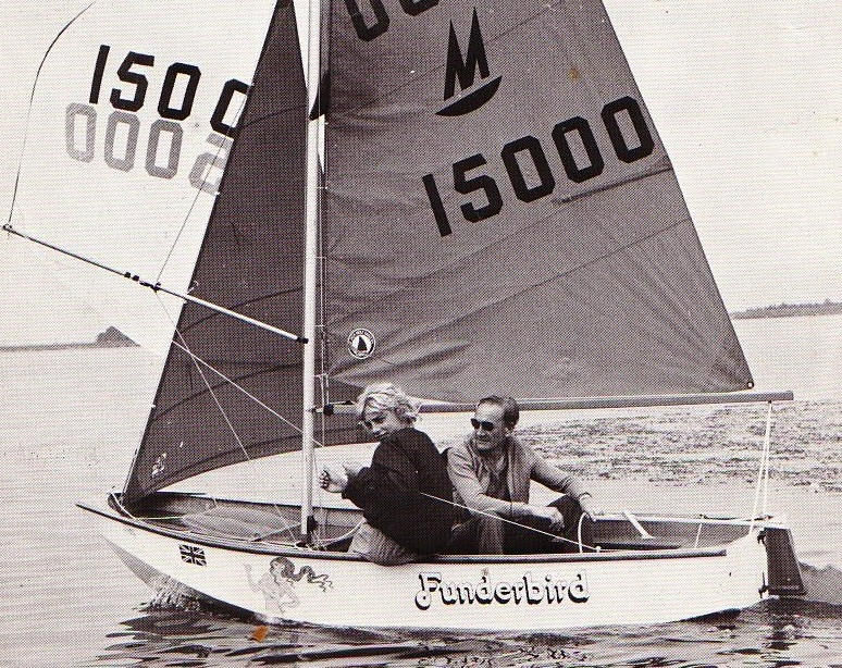 A Mirror dinghy sailing with spinnaker hoisted and helm to leeward