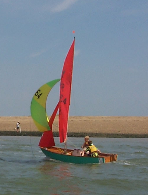 Two boys sailing a wooden Mirror at Brightlingsea