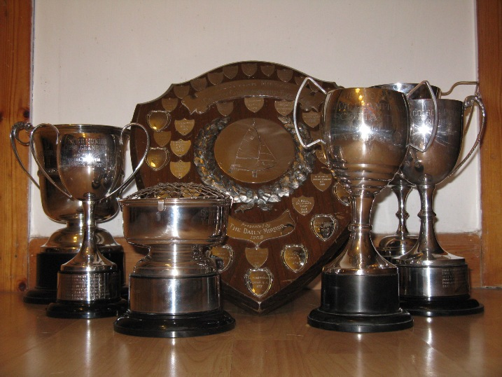 5 trophies on a table