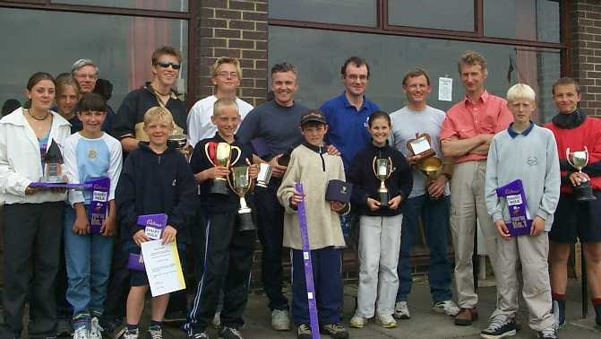 Winning helms and crews with their trophies outside the clubhouse