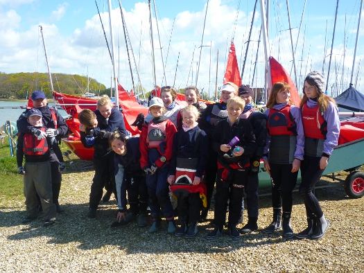 group photo of Mirror dinghy sailors at Chichester YC on a sunny day