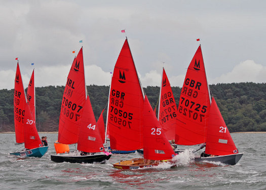 Mirror dinghies turning a leeward mark off Brownsea Island