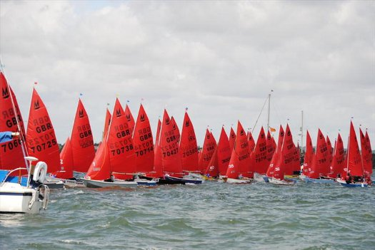 44 Mirror dinghies starting a race in Poole Harbour