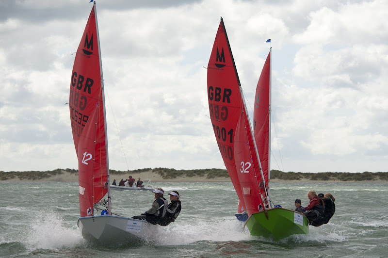 Two Mirror dinghies racing at Itchenor on a breezy day