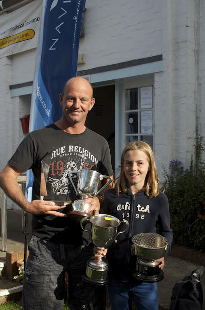 Ian and Zoe Walker with armfuls of prizes