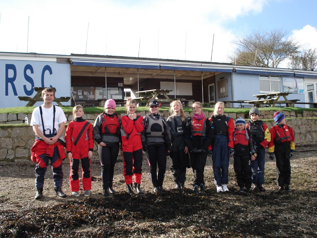 10 young sailors & coach standing on the beach at Restronguet SC