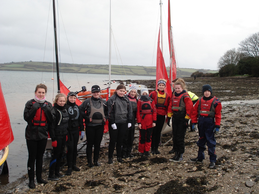 The Gul South West Mirror squad standing on a beach in their winter sailing gear