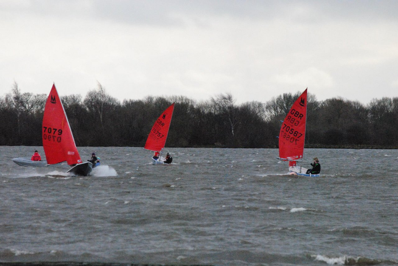Mirror dinghies sailing on a very windy lake in winter