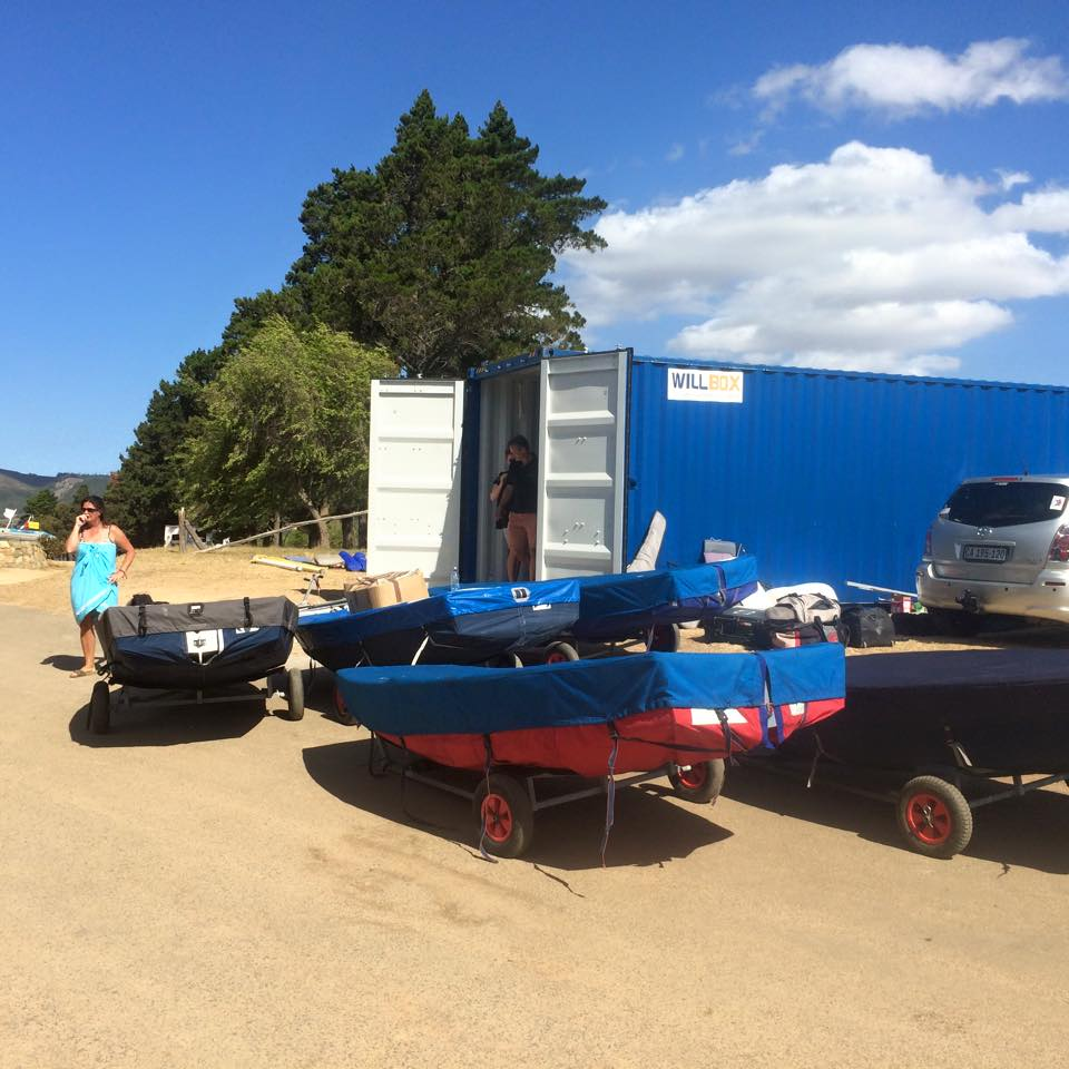 Mirror dinghies in a queue waiting to be packed into a container