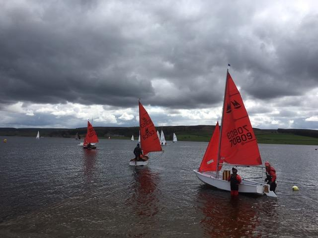 Mirror dinghies launching to race on a cloudy day