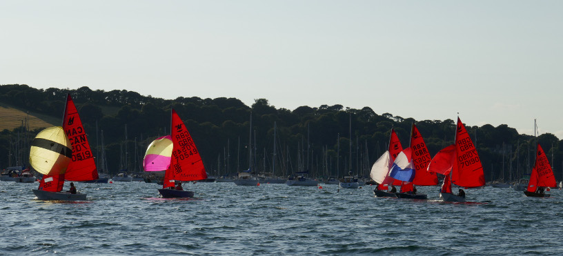 A fleet of Mirrors racing with spinnakers set