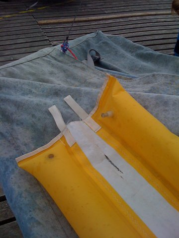 Masthead float - two yellow inflated bags joined by a strip of white sailcloth