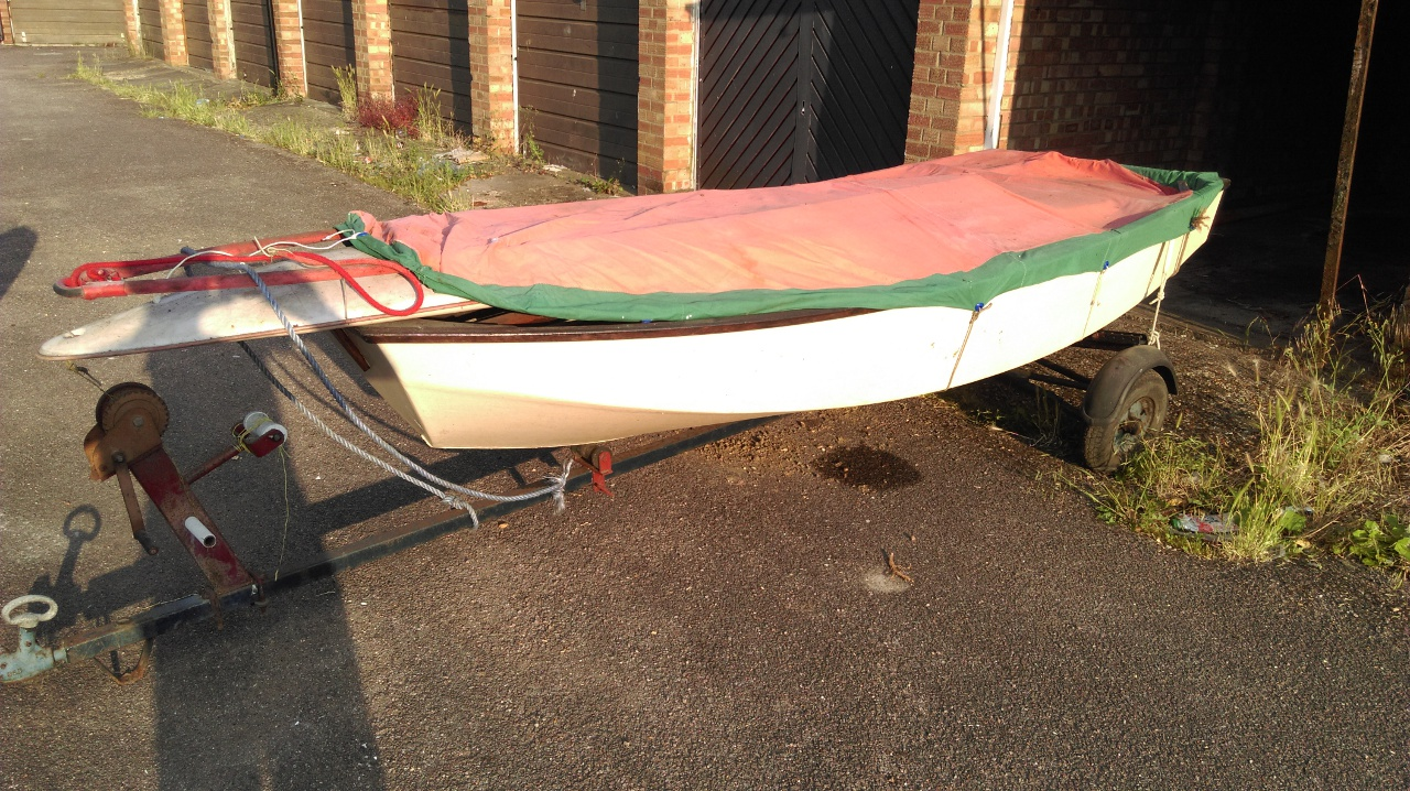 An old Mirror dinghy on a trailer