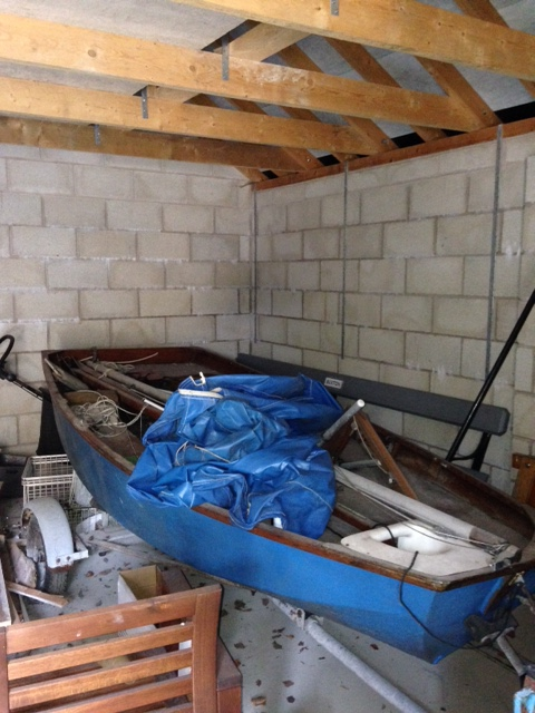 An old Mirror dinghy in a garage