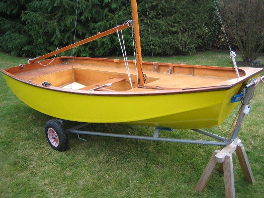 Yellow Mirror dinghy 19966 on trolley in garden