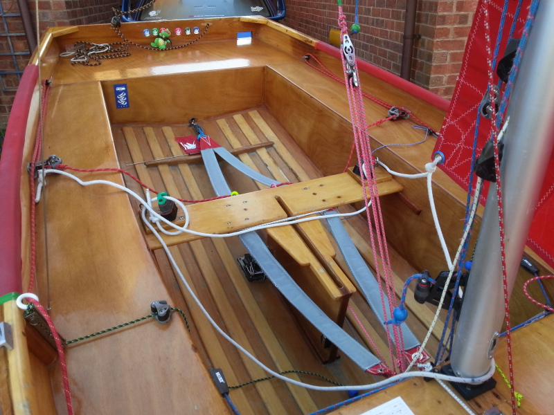 The cockpit of a Mirror dinghy  equipped with toe straps