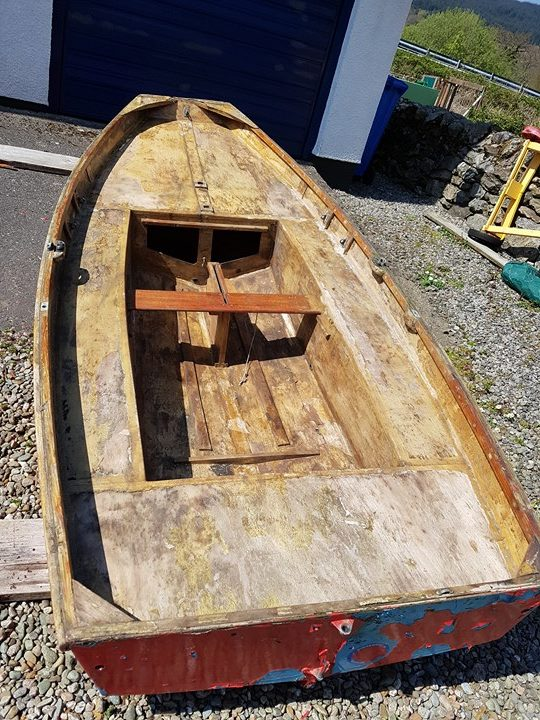 A wooden Mirror dinghy hull in poor condition