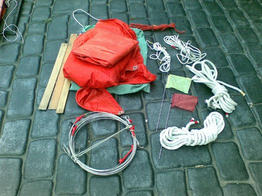 A bag of spare Miiror dinghy gear, sails, battens, ropes, burgees