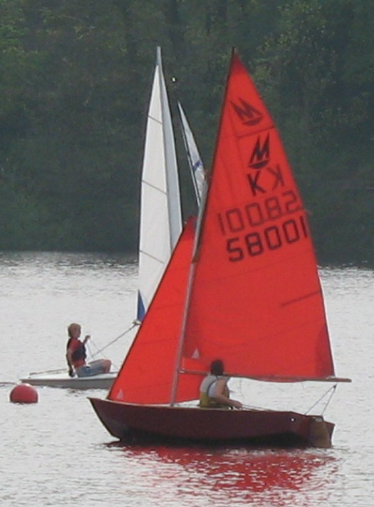 Mirror dinghy sailing on a lake in a light wind
