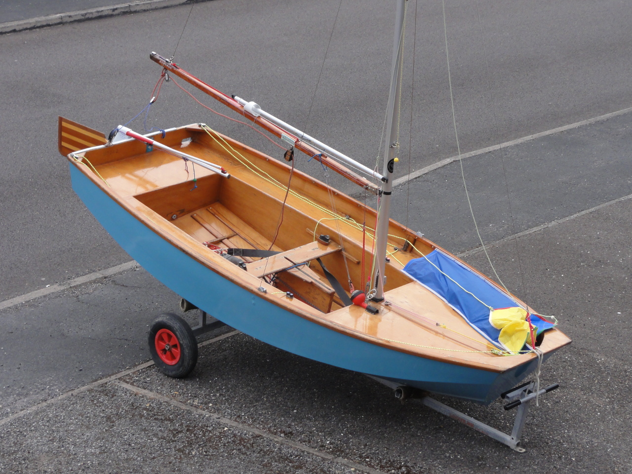 A Mirror dinghy with mast up on a driveway