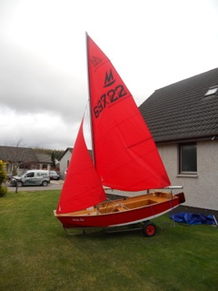 Mirror Dinghy 69722 on a lawn with sails hoisted