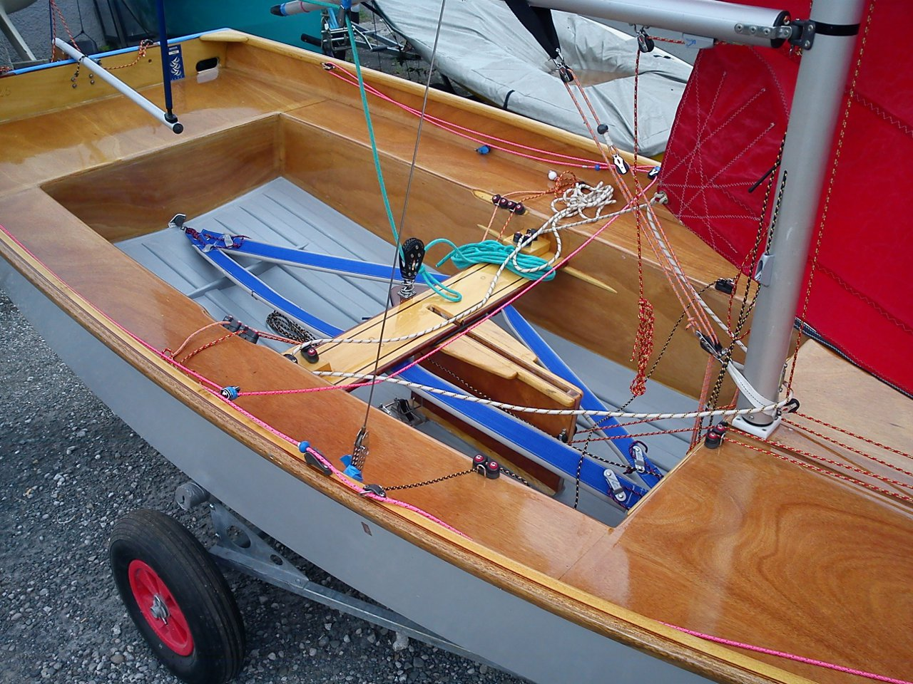 Cockpit of a Mirror dinghy fitted with padded toe straps with clam cleat fitted at the ends