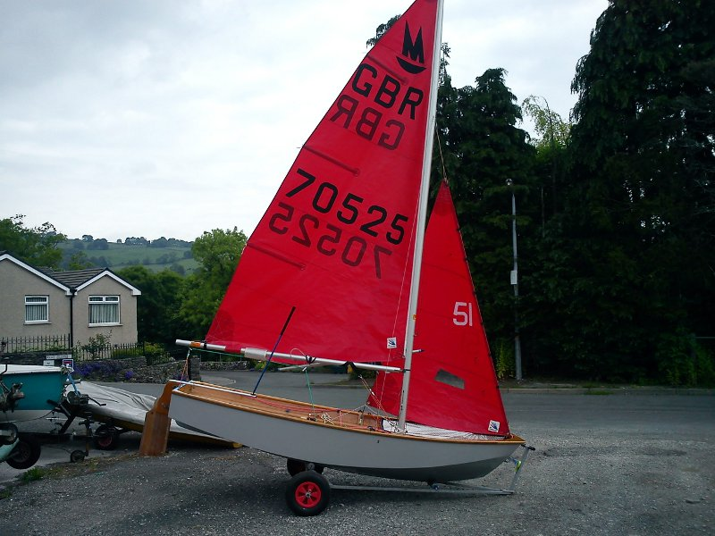 Mirror dinghy 70525 in a dinghy park with sails hoisted