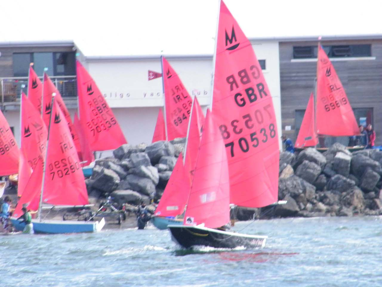 A black GRP Mirror dinghy just off Sligo Yacht Club