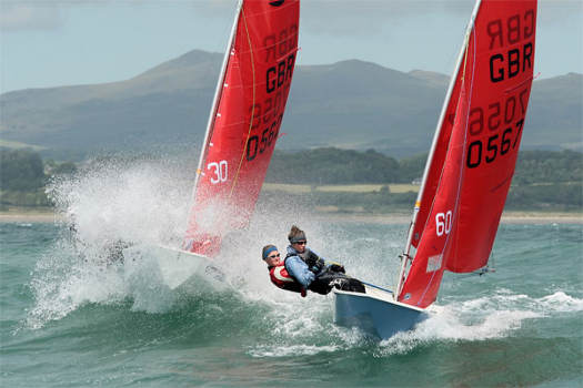 Mirror dinghies sailing in big waves at Pwllheli