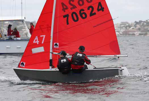 Grey GRP Mirror dinghy number 70624 crossing a finishing line