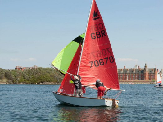 Mirror dinghy 70670 sailing in a light breeze with the spinnaker up