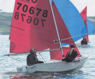 White Winder GRP Mirror dinghy sailing with blue spinnaker flying