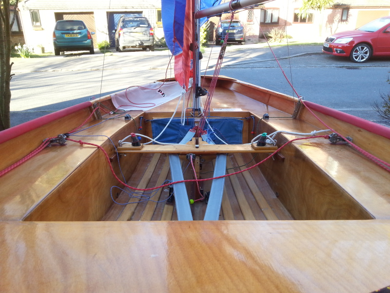 Mirror dinghy interior with shrouds attached to U channel adjusters photographed from the stern
