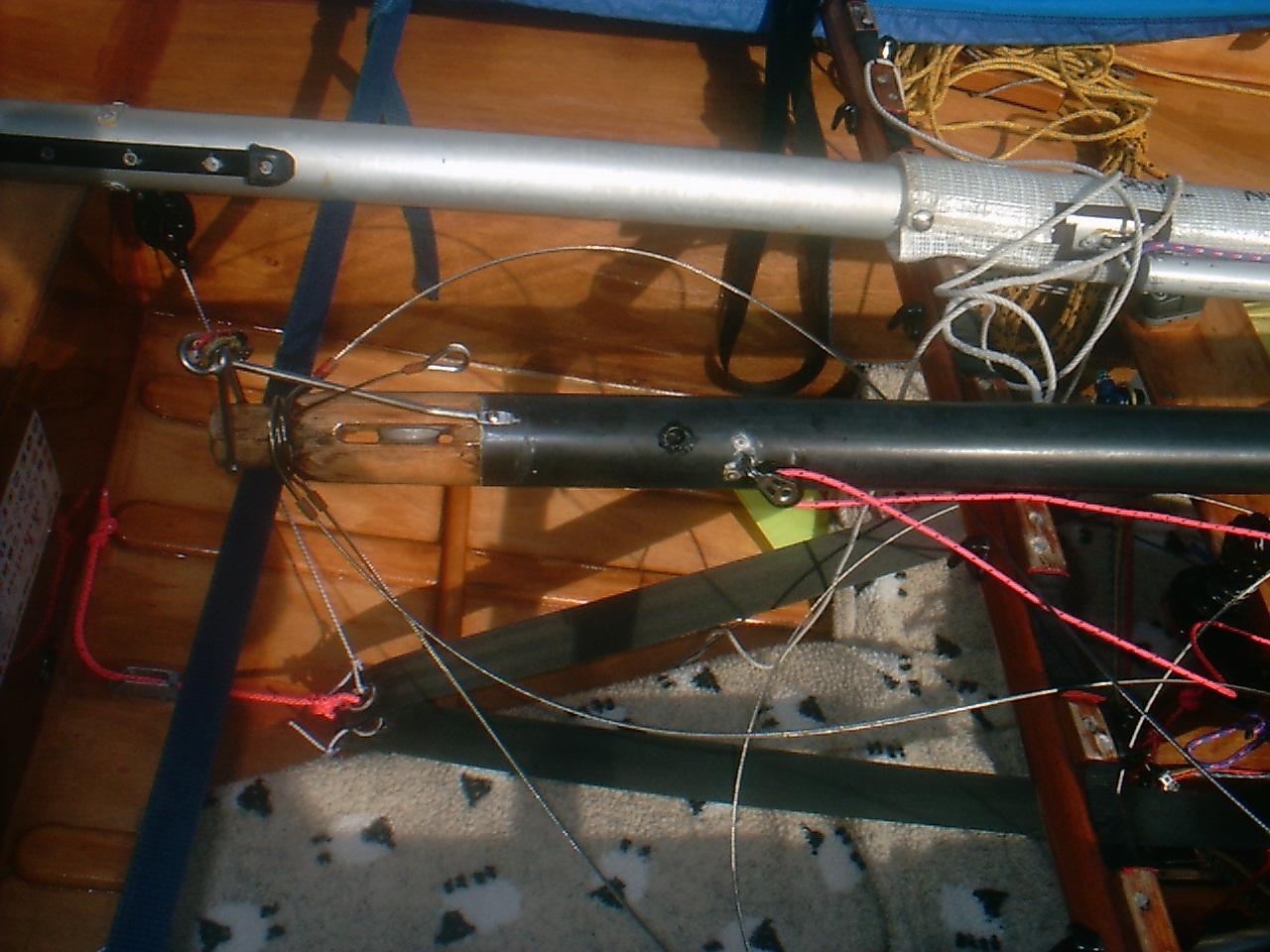 The top of a Mirror dinghy gunter mast showing spinnaker pole uphaul block