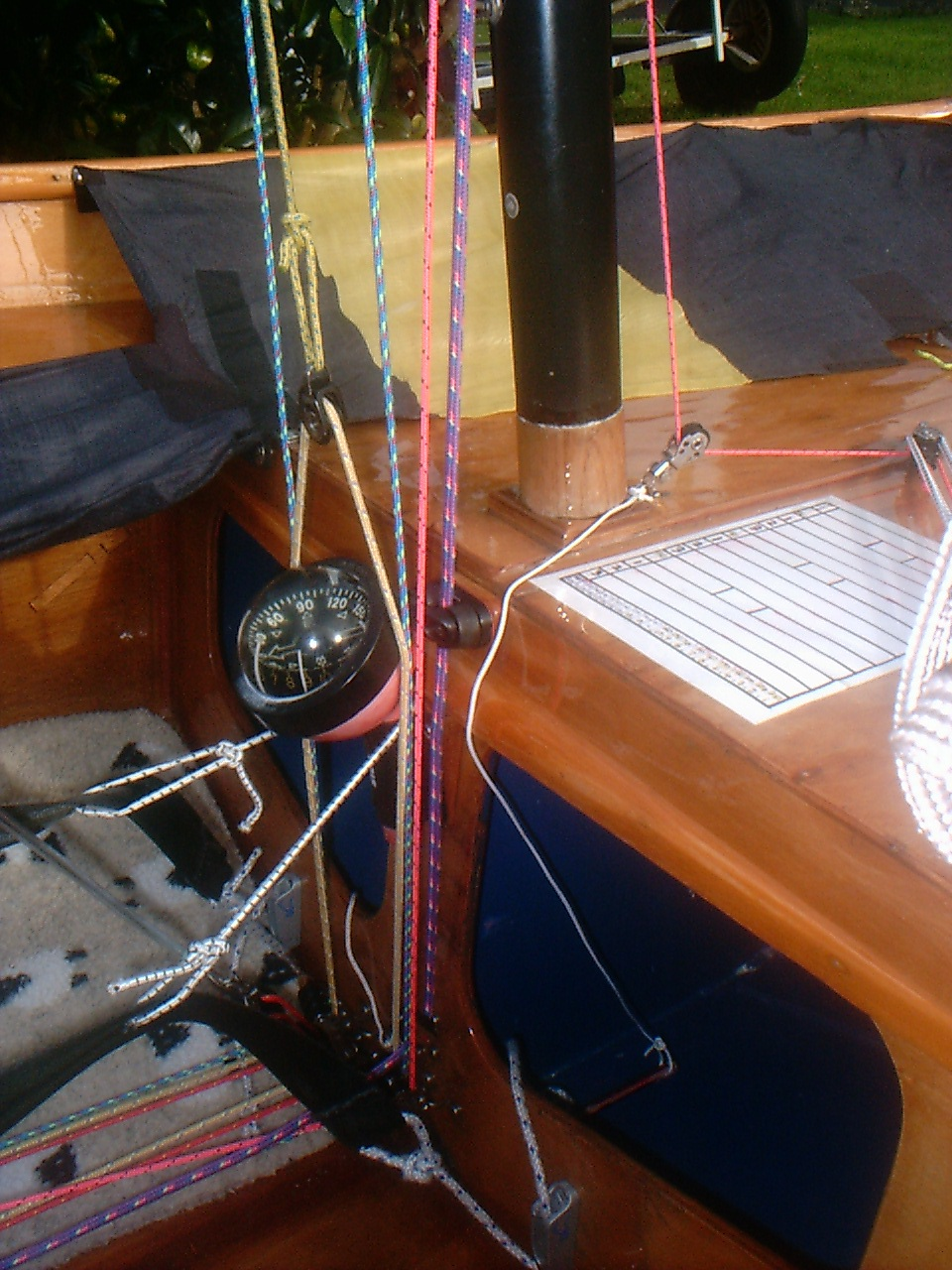 Cleat for spinnaker pole deployment line on stowage bulkhead