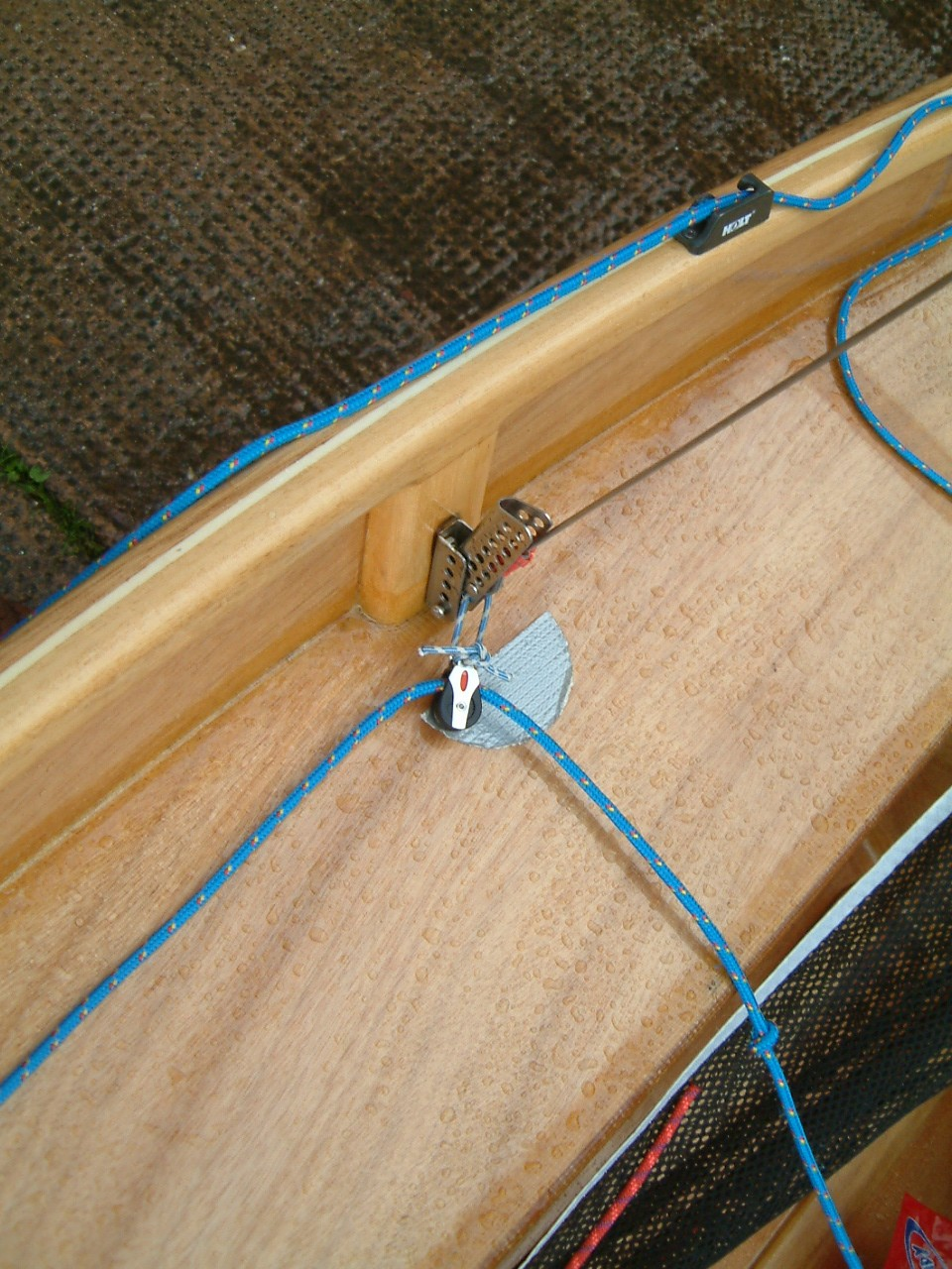 A small block attached to the shroud adjuster plate of a Mirror dinghy