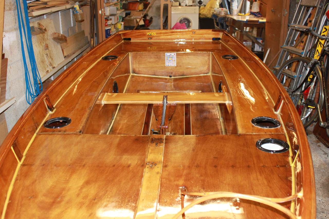 Wooden Mirror dinghy with fittings removed freshly varnished